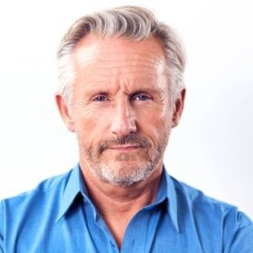 134159963 studio shot of mature man with serious expression against white background at camera